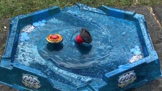 getlinkyoutube.com-Beyblade battle in the water
