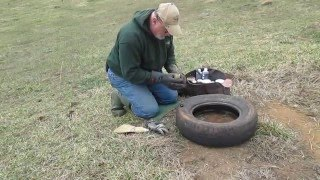 getlinkyoutube.com-David Allen resetting tire set for coyote trap