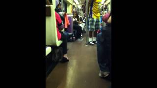 [Homeless Man On Subway Rocks Out On A Guitar] Video
