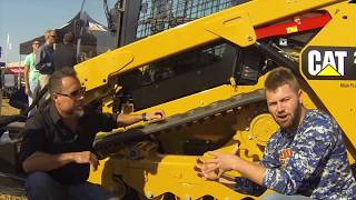 getlinkyoutube.com-Caterpillar Skid Loader Vs  BobCat Skid Steer at the GIE-Expo