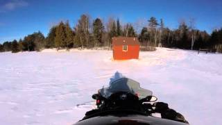 getlinkyoutube.com-Polaris Adventure 550 pulling Ice Shanty out for 2016 Ice Fishing Season