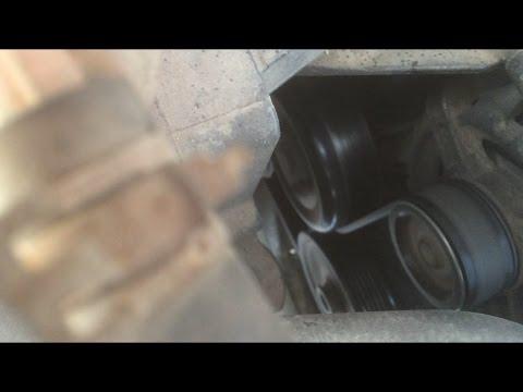 Где в БИД Е6 находится натяжной ролик ремня генератора