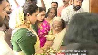 After marriage Dileep - kavya Madhavan reach Dileep's Home in Aluva