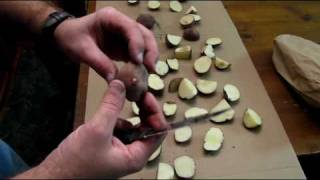 getlinkyoutube.com-Cutting potatoes getting ready to plant