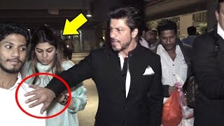 getlinkyoutube.com-ANGRY Shahrukh Khan Pushes Away A FAN To Save A Lady At Airport