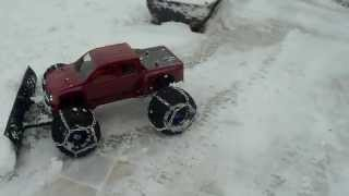 getlinkyoutube.com-Traxxas E-Maxx Snowplough. 47cm snow plough radio controlled. Snow chains.