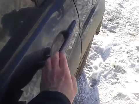 Видео: Как открыть заднюю левую дверь в Mitsubishi Outlander XL?