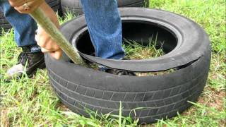 getlinkyoutube.com-How to cut a tire and make it into a garden pot.wmv