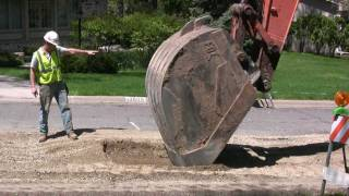 getlinkyoutube.com-EXCAVATOR EXPOSES STORMSEWER -- REMOVES COVER