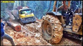 Aqui o bicho pega - Trator florestal puxando caminhão pesado no atoleiro!