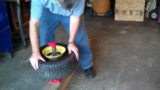 getlinkyoutube.com-How to remove tires and inner tubes from lawn tractor rim.
