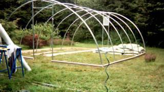 getlinkyoutube.com-Building a Hoop House in 55 Seconds