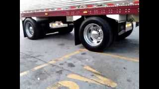 Peterbilt 379 with a stainless spread axle.