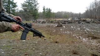 "getlinkyoutube.com-Sig 556xi 7.62 vs. AA 7.5"" Evo upgraded pistol"