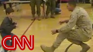 A boy with cerebral palsy walks to his Marine dad for the first time width=
