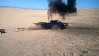 getlinkyoutube.com-Two Dumbasses Pulling A Nissan 720 With A Cummins At Pismo Beach