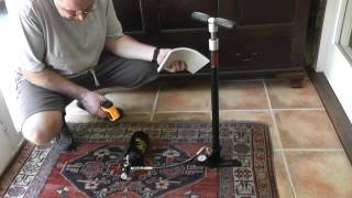 Charging a paintball air bottle with a stirrup pump