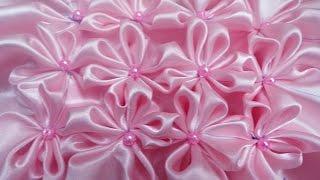 getlinkyoutube.com-8 petal flower smocking on a fabric