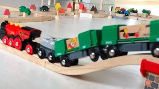 getlinkyoutube.com-BRIO & Plan City Toy cargo trains & trucks are riding on the wooden rail and road in the mini town.