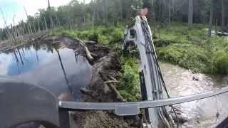 getlinkyoutube.com-Busting A Beaver Dam!  Mini Bobcat Excavator Mud Stuck Water Creek