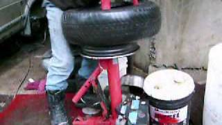 getlinkyoutube.com-Manual Tire Changer, removing the tire from the rim