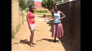 getlinkyoutube.com-Kansiime Anne against the mini skirt.