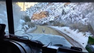 Peterbilt 379 driving down 15% grade in Utah oil feild
