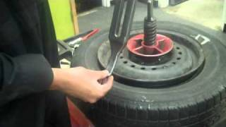 getlinkyoutube.com-Removing tire using old school tire machine by: Karn M.