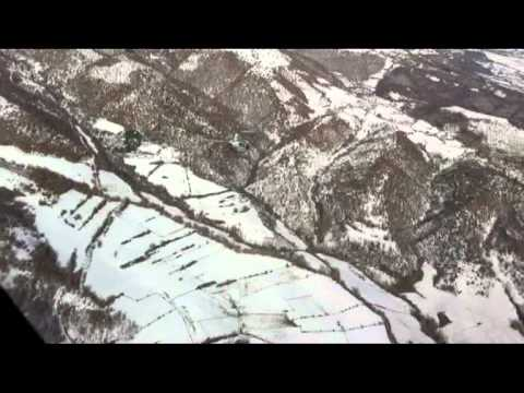 elicottero r22  volo sulle nevi con cinghiali (flight on the snow with wild boar and deer)