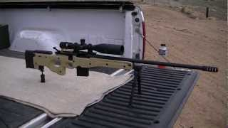 getlinkyoutube.com-.308 Remington 700 ~ 1012 yard shot at a gallon of milk