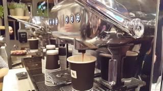 Nespresso Aguila Machine Making Cappuccino