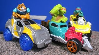 getlinkyoutube.com-TMNT T-Machines Tiger Claw In Safari Truck, Raph in Monster Truck, Mikey In Patrol Buggy