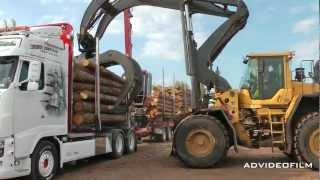 getlinkyoutube.com-Unloading timber truck with high-lift.
