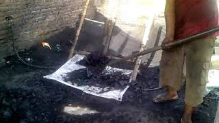 getlinkyoutube.com-Coconut shell charcoal Natural Kiln System.mp4