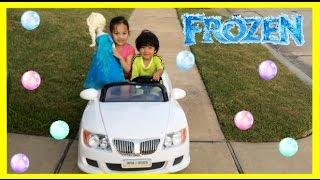 getlinkyoutube.com-Kid Playing Outside riding car blowing bubbles with Giant Frozen Elsa Doll Ryan ToysReview