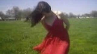 getlinkyoutube.com-Open Field Wind Blowing Dress and Hair Around windy flies standing in the loud blows woman model