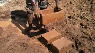 getlinkyoutube.com-Making Mud Bricks in Rwanda