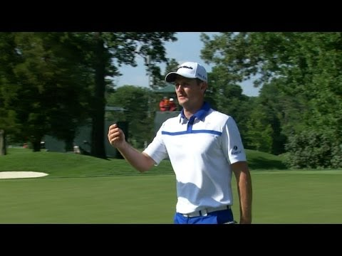 Justin Rose rolls in a 20-foot putt from the fringe for birdie at Quicken Loans
