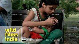 getlinkyoutube.com-Girl feeding infant with a milk bottle