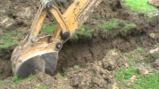 Case 580L Turbo Digging Trench