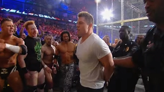getlinkyoutube.com-Arrests are made during the chaotic aftermath of the WWE Triple Threat Match: Hell in a Cell 2011