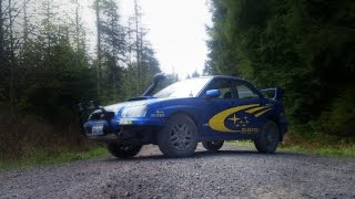 getlinkyoutube.com-lifted subaru wrx with snorkle muddin and wheeling hill climbs and lots of mud