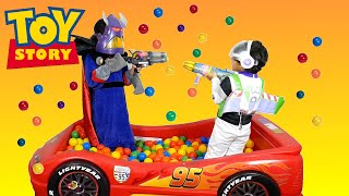 getlinkyoutube.com-Surprise Toys GIANT Ball Pit Challenge Toy Story Buzz vs Zurg Disney Cars Ball Pit Surprise Toys