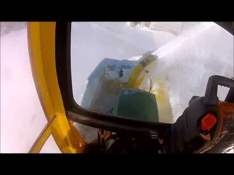 John Deere 455 With Cab Blowing Deep Snow. 47 Inch Two Stage With X Series Mount.