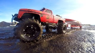 RC ADVENTURES - Mega Mud Truck Blows Motor pulling Speed Boat