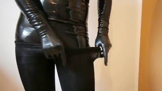getlinkyoutube.com-Dressed black pantyhose encasement over latex catsuit