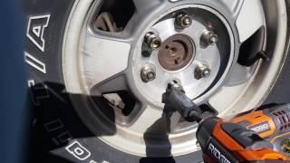 getlinkyoutube.com-Craftsman  vs Rigid impact drivers on Tahoe lug nuts