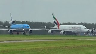getlinkyoutube.com-A380  vs MD-11 at takeoff form AMS Schiphol