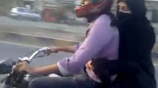 getlinkyoutube.com-Boy wheeling on Bike with his Girl Friend
