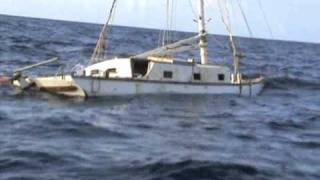 getlinkyoutube.com-Two sailors on the ocean in a sinking boat.